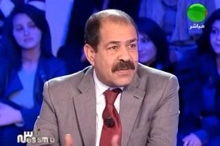 photo 6 Chokri-Belaid cravatte rouge télé